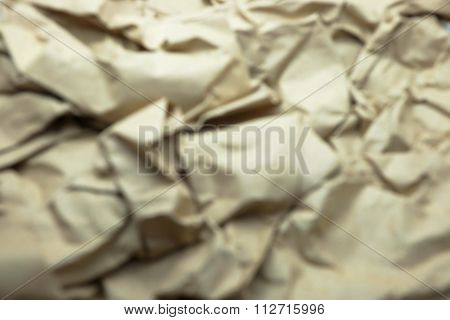 Blurred photo of brown wrinkled paper texture background.