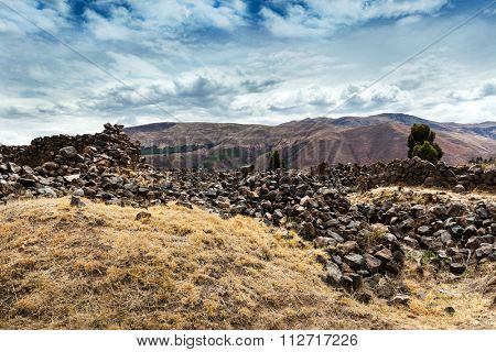 crumbling wall of the Incas in the mountains