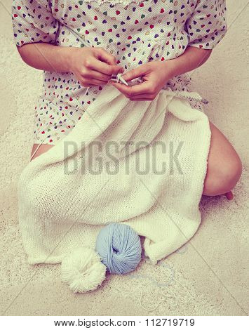 Woman Knitting With White Wool.