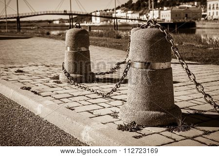 Stub Posts Linked In A Chain On A Quay