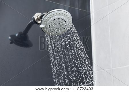 Shower Head In Bathroom With Water Drops Flowing