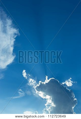 Rays Of Sunbeam On Blue Sky With Clouds