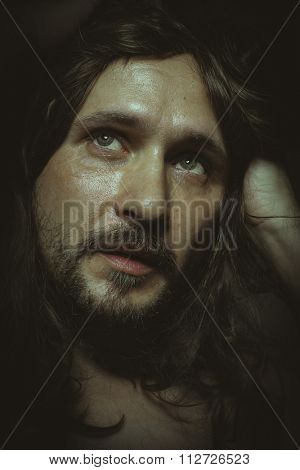 Christian, jesus christ with long hair in the foreground, a man of deep look