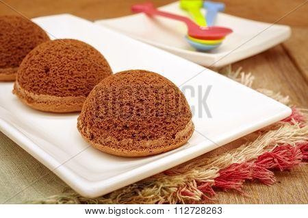 Chocolate chiffon dome cake on white plate