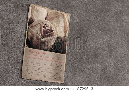 3d rendering of an old calendar page on grey textured background. December 1939