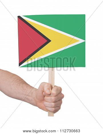 Hand Holding Small Card - Flag Of Guyana