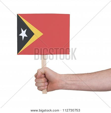 Hand Holding Small Card - Flag Of East Timor