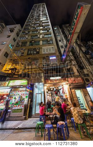 Hong Kong, China - Circa September 2015: High-rise Apartment Building And Street Restaurant In Kowlo