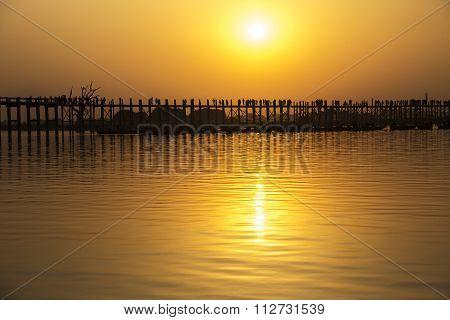 Silhouetted People On U Bein Bridge At Sunset, Amarapura, Mandalay Region, Myanmar