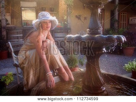 Blonde Lady With Feet In Water Fountain