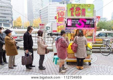 Japanese people buying lottery at the counter