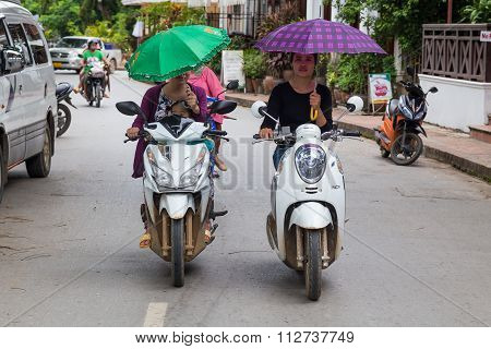 Luang Prabang, Laos - Circa August 2015: Girls Driving Motorbikes On The Streets Of Luang Prabang,