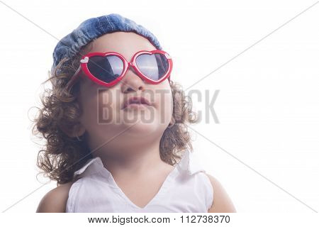 Isolated Child With Red Sun Glasses And Blue Hat