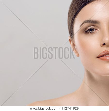 Young Beautiful Half-face Woman Portrait With Healthy Skin Studio