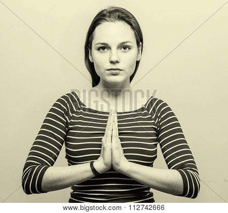 Young Woman Namaste In Fashion Stripes Clothes Hipster Casual Posing On Light Background