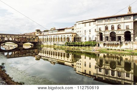 Beautiful Ponte Vecchio, Vasari Corridor And Uffizi Gallery Are Mirrored In The River Arno, Florence