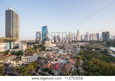 Jakarta, Indonesia - Circa October 2015: Slums And Skyscrapers Of Jakarta, City Of  Contrasts