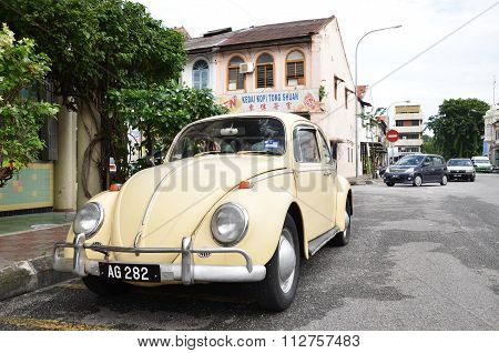 Classic Vw Beetle Parked On The Roadside Of Ipoh Town, Malaysia