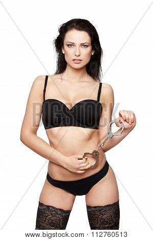 Sexy Woman Holding Handcuffs Isolated