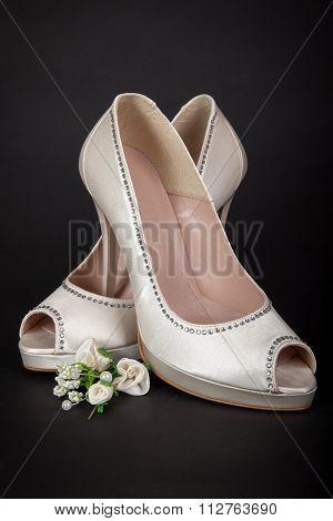 Elegant White Female Shoes On Dark Background. Bride Shoes