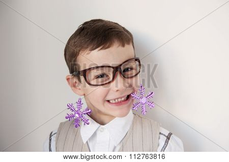 boy with glasses attached to them snowflakes smile showing teeth