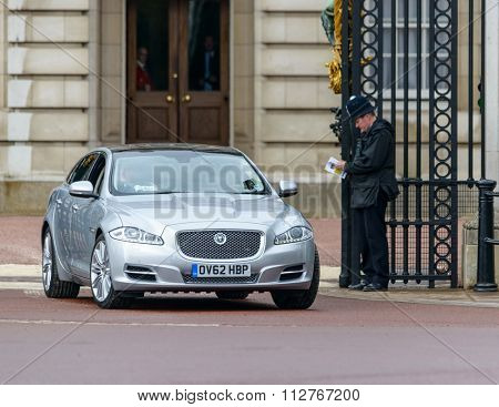 LONDON, UK - CIRCA MAY 2013: A Jaguar XJ leaves Buckingham Palace.