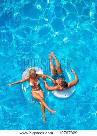 Couple having fun at the swimming pool