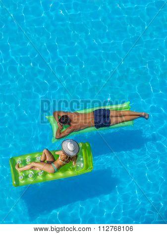 Couple having fun at the swimming pool