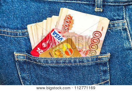 Russian Rouble Banknotes With Credit Cards Visa And Mastercard Sticking Out Of The Back Jeans Pocket