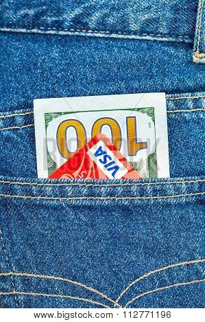 One Hundred Dollars Bill And Credit Card Visa Sticking Out Of The Back Jeans Pocket