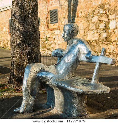 Public statue on bench on Upper town in Zagreb, Stross promenade