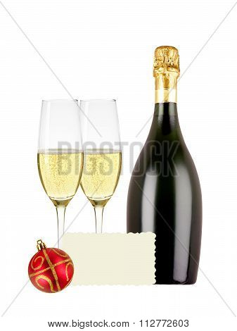 Two Glasses Of Champagne, Bottle, Greeting Card And Red Christmas Ball Isolated On White