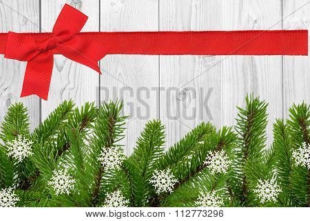 White Wooden Desk And Red Bow, Ribbon And Green Christmas Tree