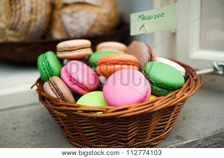 Basket Full Of Macaroons On A Cafeteria Shelf