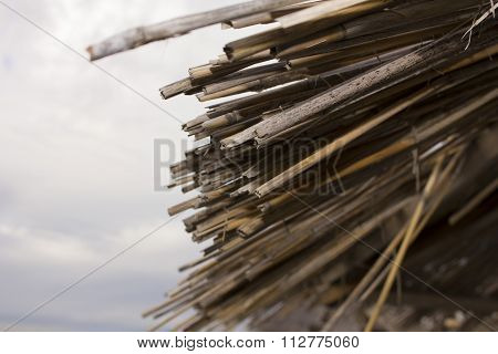 Thatched Roof On A Beach Umbrella
