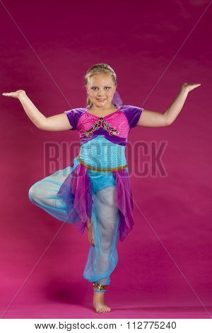 A young child posing in a studio environment
