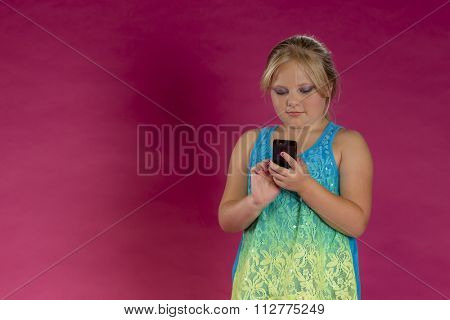 A young child posing in a studio environment with an electronic device.