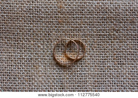 Wedding golden rings on the background of mats