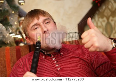 Man Smoking Hookah