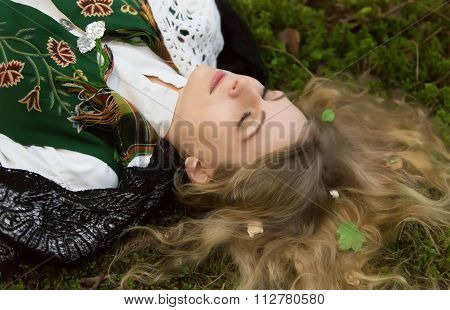 Young Girl Lying On The Ground