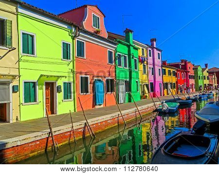 Canal Reflection of The Painted Shops of Burano - Burano, Italy