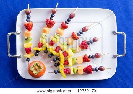 Creative Arrangement Of Colorful Fruit Kebabs