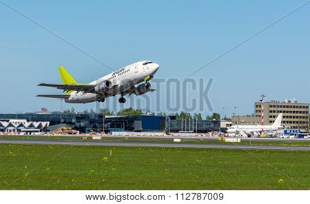 Air Baltic Airlines Boeing 737 leaving Riga International Airport Latvia