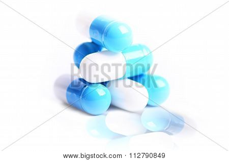 Tablets. Pills on a white background. Isolated. Building from pills. Pharmacy. Medical background.