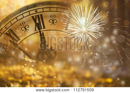 New Year's at midnight - Old clock with fireworks and holiday lights