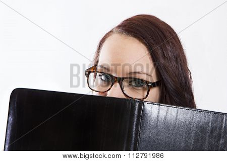 Beautiful Girl Hiding Behind Leather Folder