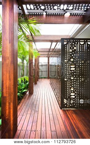 A Beautiful Eye Catching View Of House Lawn With Wooden Floor An