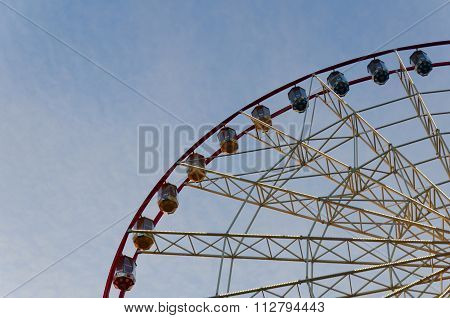 Part Of Ferris Wheel With Cabins On The Background Of Cirrus Clouds. A Horizontal View