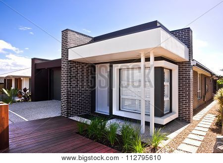 A Beautiful Outside View  Of House  With Wooden Floor And Garden