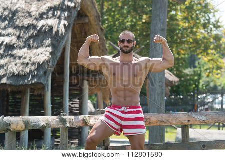 Double Biceps Pose Outdoors In Summer